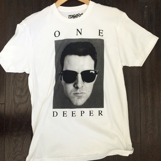 Screenprinted Dillon Francis One Deeper grayscale t-shirt featuring his face wearing sunglasses